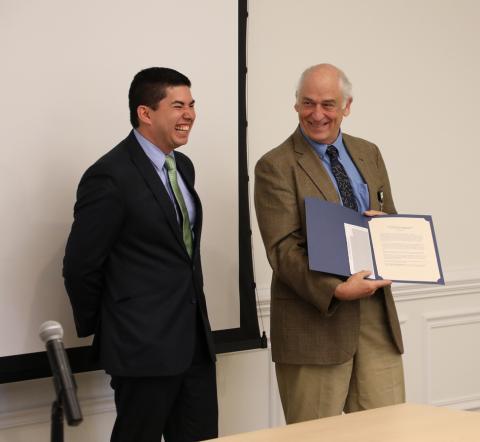 Dr. Dennis Clements presents award to Estuardo.
